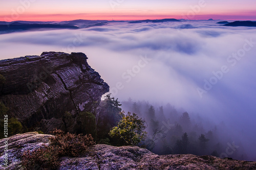 Canvas Aubergine Dramatic sunrise on the rocks. Amazing sky and clouds, fog in a valley, forest. Trees, rocks, sky, peace, quiet, relax, travel, adventure.