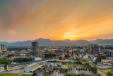 Scenery of Sunset at Ipoh,Perak,Malaysia with aerial view. Soft focus,Blur due to Long Exposure. Visible Noise due to High ISO.