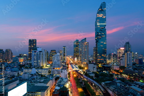 Poster Bangkok Transportation at Dusk with Modern Business Building from top view in Bangkok, Thailand.