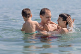 Father and sons playing in the sea, Corfu island, Greece - 213158858