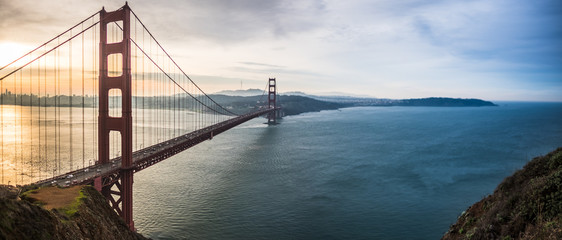 Sunrise looking at the Golden Gate Bridge - good morning - yellow to blue sky © Larry Zhou