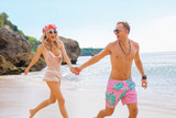 Boyfriend and girlfriend running on the beach