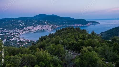 Plexiglas Zonsopgang Aerial view of Skopelos harbour and town before sunrise, island of Skopelos, Greece