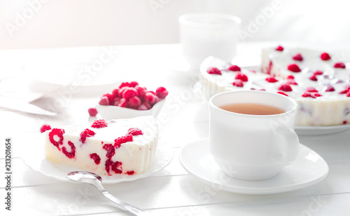 Wall mural Panna cotta raspberries on a wooden table