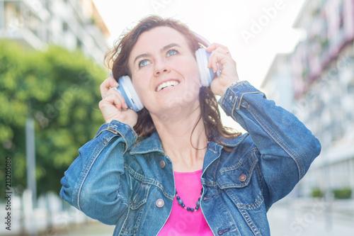beautiful woman listening music with headphone - 213205080