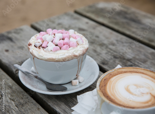 Canvas Chocolade A luxury hot chocolate drink in a posh cup and saucer with whipped cream and marshmallows melting on top