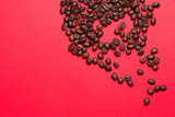 Coffee grains on a red background close-up - 213216287