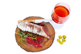 Sliced cured bresaola with a sprig of rosemary for a glass of wine. - 213218449