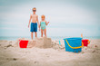 toys and kids playing on the beach - 213226437