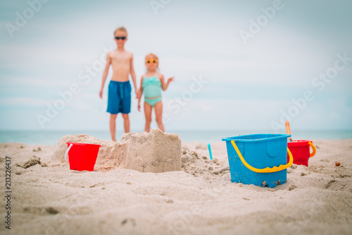toys and kids playing on the beach