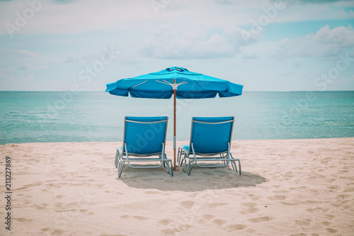 Foto Murales Two beach chairs on tropical vacation