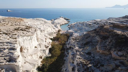 Aerial drone bird's eye view of iconic lunar volcanic white chalk iconic beach and caves of Sarakiniko, Milos island, Cyclades, Greece © fabdrone