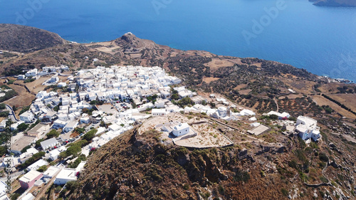 Poster Aerial drone bird's eye view photo of picturesque peak in chora and castle of Milos island overlooking endless blue of the Aegean sea, Cyclades, Greece