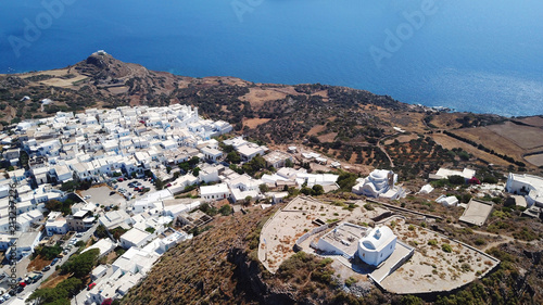 Aerial drone bird's eye view photo of picturesque peak in chora and castle of Milos island overlooking endless blue of the Aegean sea, Cyclades, Greece - 213237226