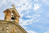 Old stone orthodox church and bell on blue sky, in Greece. - 213247420
