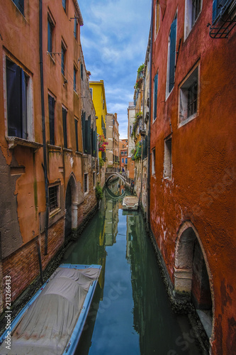 Venice, Italy - June, 28: boats on a channel in Venice, Italy - 213266433