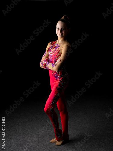Fotobehang Fitness Girl gymnast on a black background