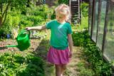 Little girl gardening - 213290825