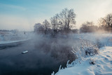 Winter landscape with trees at the riverbank - 213291480