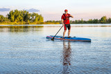 senior paddler on stand up paddleboard - 213300829