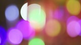 Slow motion video of colorful lights out of focus - 213312426