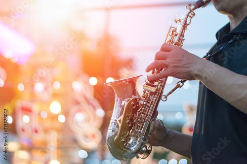 International jazz day and World Jazz festival. Saxophone, music instrument played by saxophonist player musician in fest. - 213328042