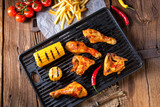 Rustic Grilled chicken wings,legs,and spicy corn - 213333656