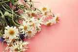 camomile   daisy and a cornflower bouquet on pink bright light gentle background a postcard vintage