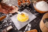 Baker hands smears butter - 213336038