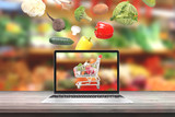 Buy fresh organic vegetables with laptop computer concept. Vegetables fall i cart on computer display. - 213342261