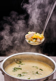 saucepan of soup with steam - 213347082