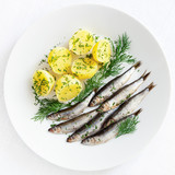 freshly salted sprats with boiled potato and dill - 213366899