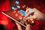 Female hands touching tablet with colorful social media icons - 213391265