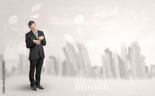 Fototapeta Young elegant businessman with city and report dream concept