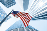 View of American flag on blue building background - 213395801