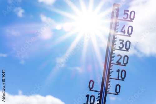 Foto Murales bright sun with thermometer. Summer background