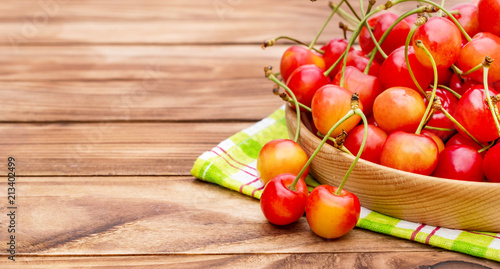 Fotobehang Kersen Plate with ripe cherries on kitchen towel. Space for text.