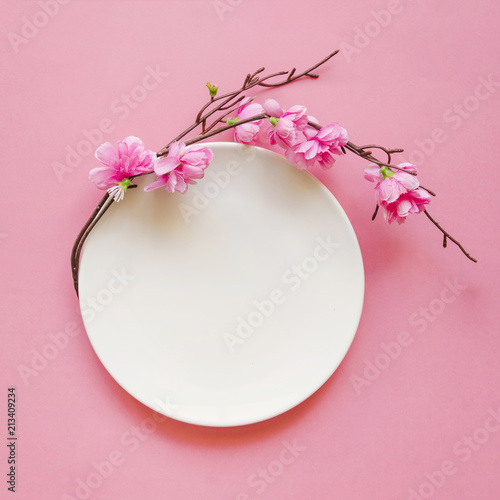 Blank white frame and pink flowers with pink background
