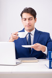 Young handsome businessman employee working in office at desk - 213410406