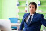 Businessman working in the office - 213423866