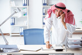 Arab businessman working in the office - 213425637