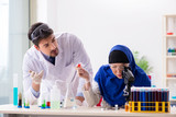 Two chemists working in the lab - 213428616