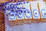 cake and bouquet of lavender on a wooden table - 213434231
