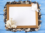 Frame of sea stones and seashells on a blue wooden background - 213445075