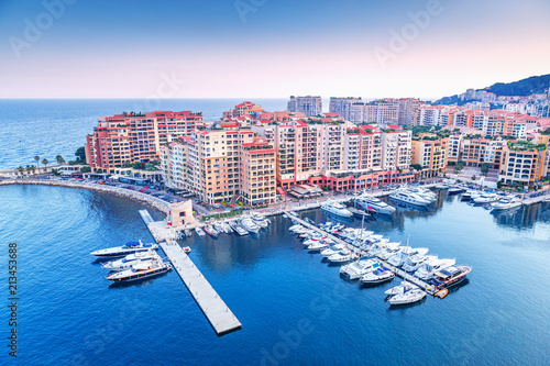 Leinwanddruck Bild Monaco, Europe. Panoramic scenic view on fashionable apartment district and port Fontvieille in Monaco - small country, symbol of wealth and richness. Beautiful evening skyline of Monaco.