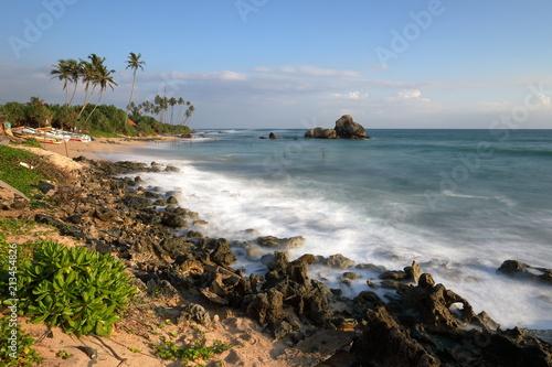 Die Stelzenfischer von Sri Lanka am Strand von Koggala