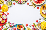 Summer various colorful sliced tropical fruits and berries in plates and bowls on white  background, top view, frame. Clean and healthy lifestyle  background - 213466024