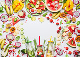 Summer clean and healthy lifestyle and fitness background with various colorful sliced fruits, berries, vegetables ,herbs,  infused water in bottles on white  background, top view, frame