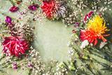 Pretty summer garden flowers frame on green background, top view - 213466484