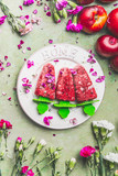 Homemade fruits and berries ice cream or popsicles on plate , decorated with garden flowers on teal rustic green table background, top view. Vintage style. Country style summer food - 213468430